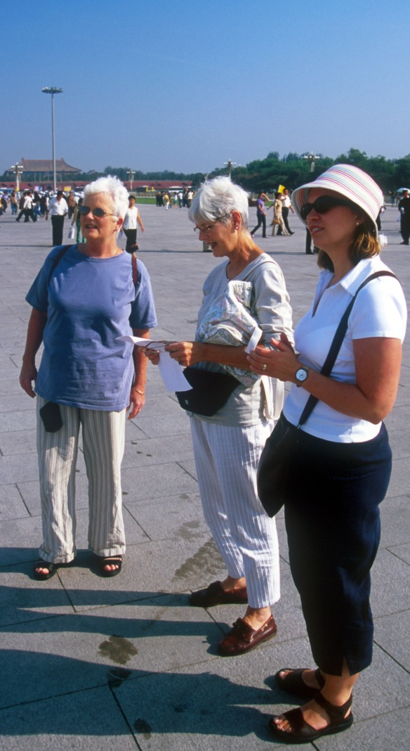 Reciting the poem in Tiananmen Square in 2005. Celia Cummins, Judy Smith and Victoria Smith